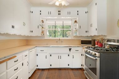 Lovely vintage kitchen with bamboo flooring and stainless steel appliances which are included.