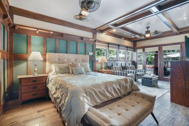 Master bedroom suite with beamed ceiling and large sitting area.