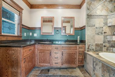 """Master bathroom """"champagne"""" tub with water jets."""