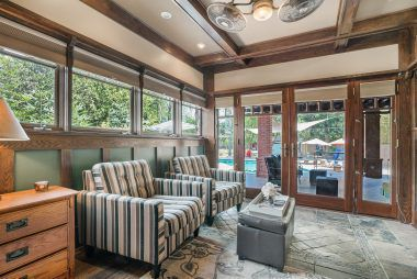 Large master sitting area with French doors leading to the deck which overlooks the tropical pool.