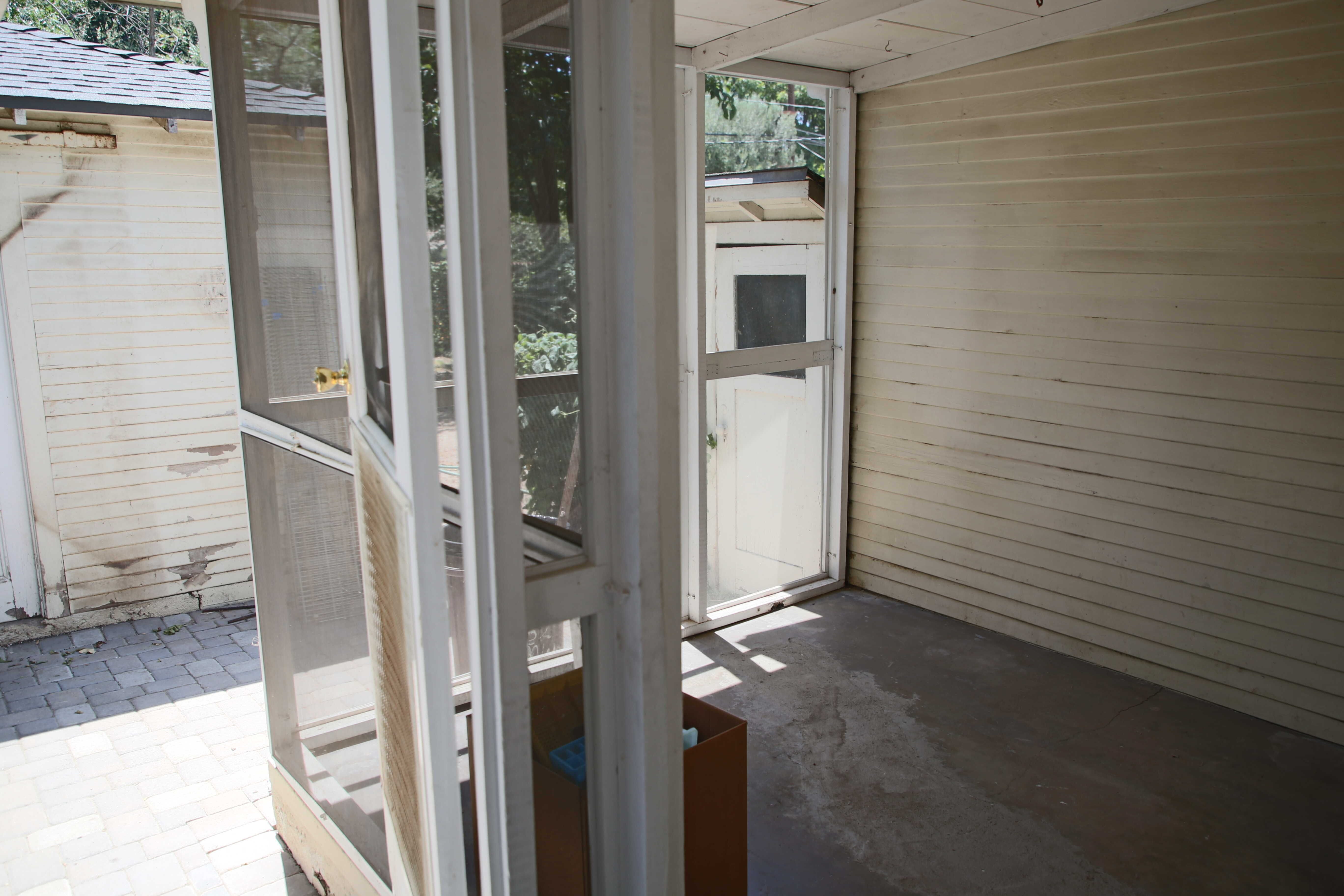 Screened-in porch off the back of the house. Was used as a catio.