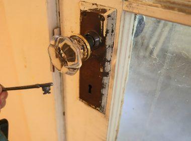 Original glass door knob with functioning skeleton key.