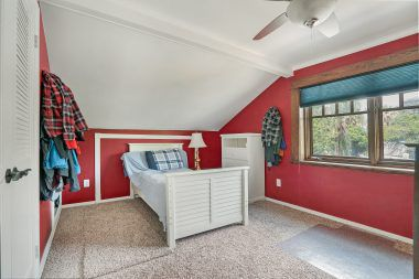 Spacious upstairs bedroom (1 of 2) with ceiling fan and brand new carpet.
