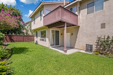 Gorgeous fenced yard with lovely landscaping and private master balcony up top, as well as covered patio off the dining room.
