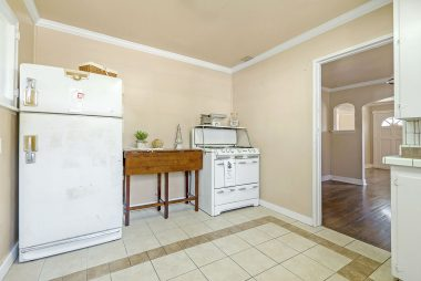 Kitchen is spacious enough to accommodate a preparation island. Vintage refrigerator and stove remain with the house.