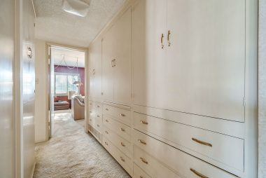 Long hallway with huge bank of drawers and cabinets for linens and things.