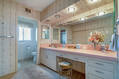 Aside from the wallpaper and pink original tile (in like-new condition), this bathroom is very spacious with a large vanity and a huge closet.