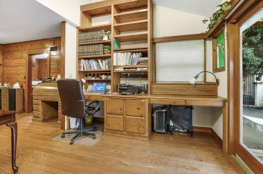 Two built-in desks, and floor-to-ceiling shelves and drawers.