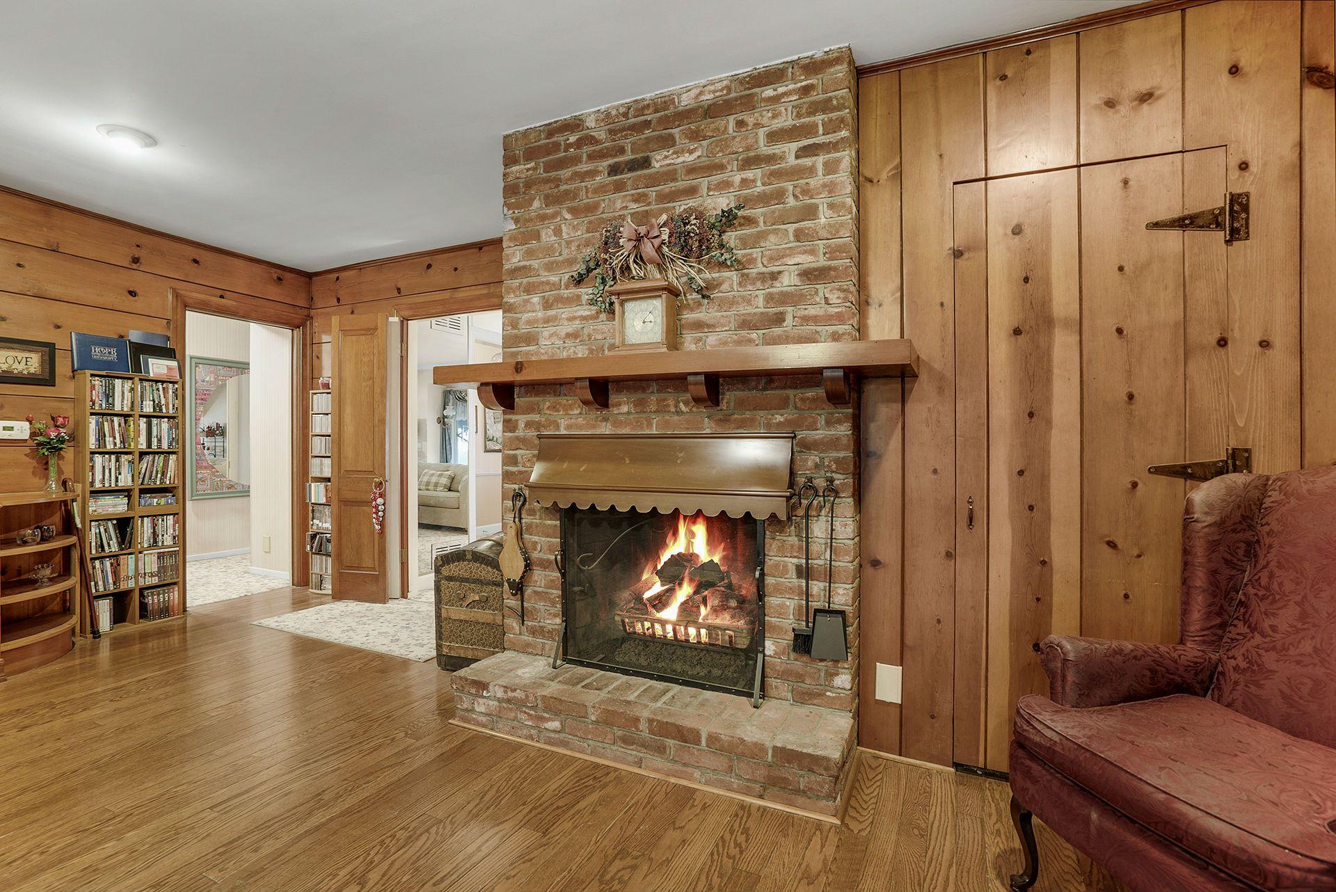 Family room fireplace with wraparound mantel.