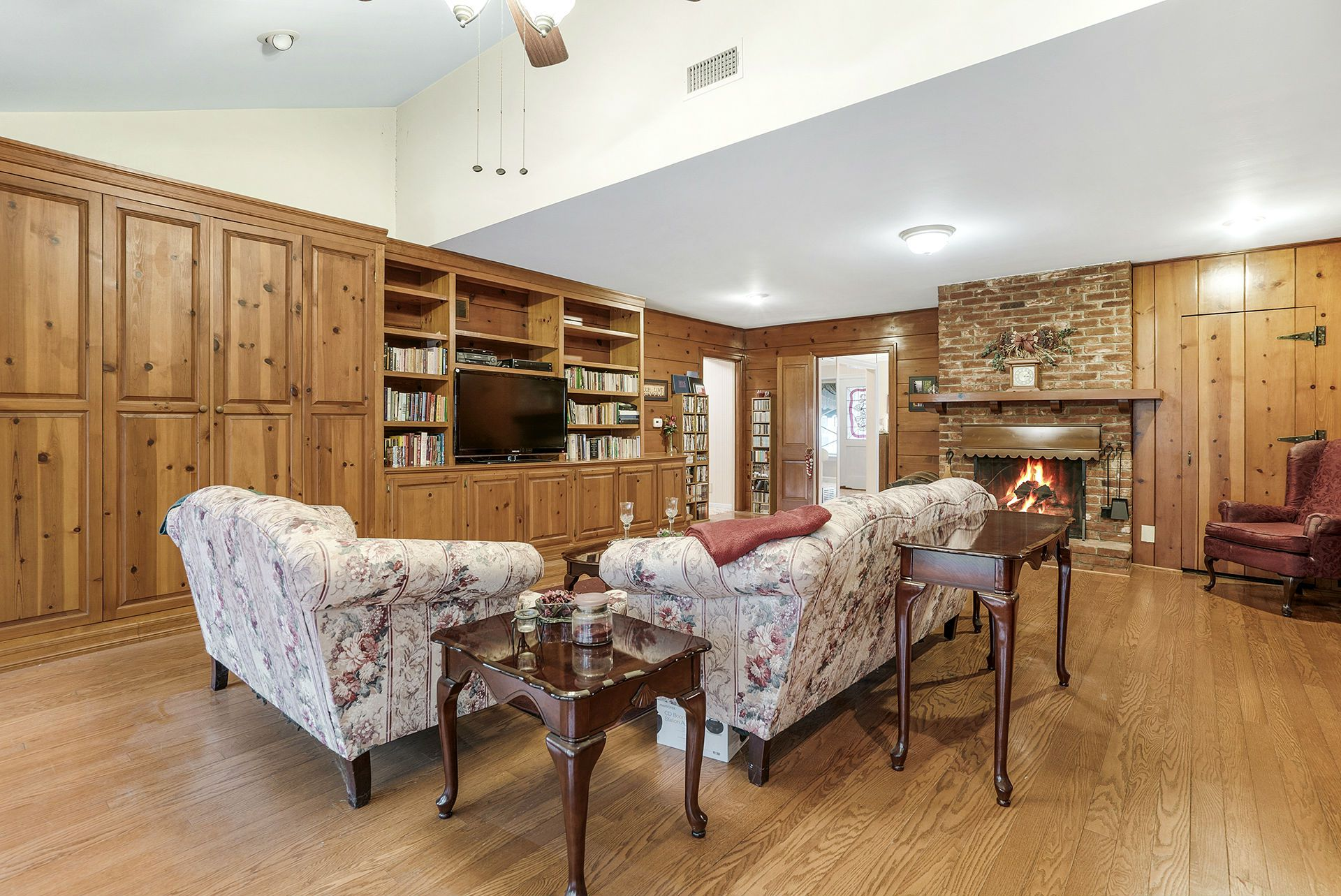 Alternate view of Family Room -- look at all of the storage, room for large television, and think of the game nights you could have in this room too!