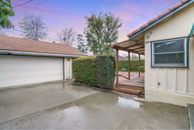 2-car garage with roll-up door and additional room for laundry and storage.