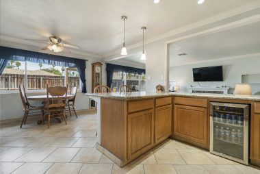 Beverage refrigerator, even more cabinet space, and this open floor plan allows you to communicate with family or guests while preparing meals.