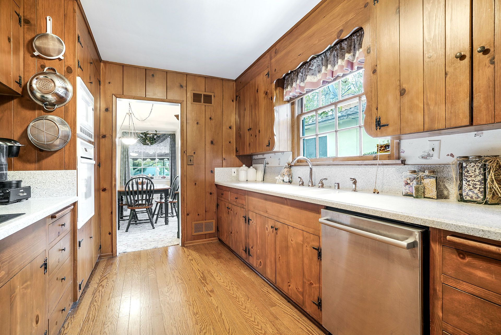 Spacious Corian counter tops in this large and functional kitchen with newer oven, built-in microwave, and Bosch dishwasher.