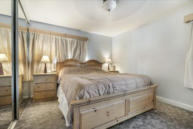 Master bedroom with mirrored wardrobe doors and private remodeled master bathroom.