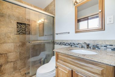 Remodeled master bathroom with granite counter top.