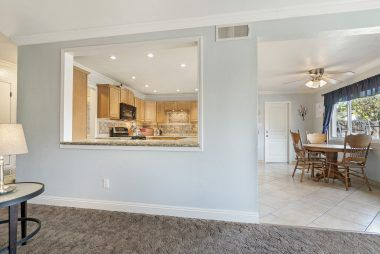 Alternate view from living room of open concept kitchen and dining area.