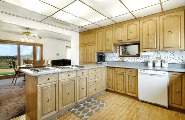 View of updated kitchen as you enter the front door with view into the formal dining area.