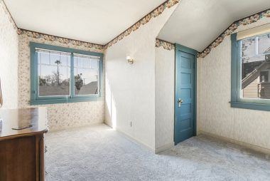Alternate view of Bedroom #2 with large closet and view overlooking the backyard pool.