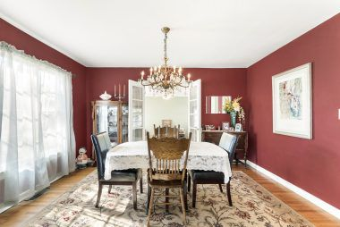 Formal dining room with French doors leading to the sunroom.