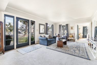 Front door entry into the living room with view into the family room.