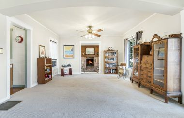 Alternate view of living room with view into the sitting room.