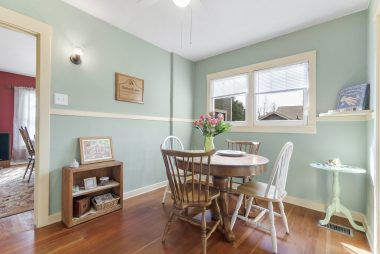 Informal dining in kitchen with formal dining room through doorway to the left.