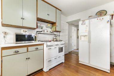 Antique stove included, and doorway leads to 2nd story stairwell.