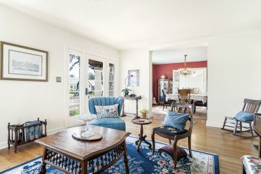 Family room with view into the formal dining room.