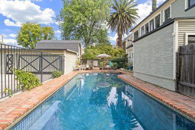 Fenced black bottom pool.