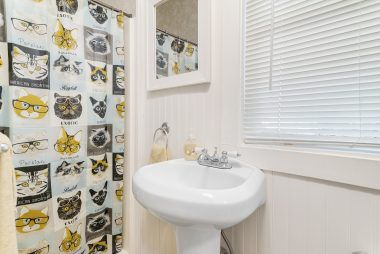 3/4 bathroom off the kitchen (convenient for guests)