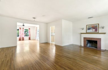 View into the living room (and formal dining room in the back) as you enter this beautiful home. Original hardwood floors throughout. Wood-burning fireplace with capped gas line that could be hooked up to the fireplace.