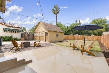 Spacious pool-sized backyard with 2-car detached garage.