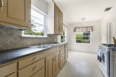 Freshly painted kitchen with tiled back splash and nook area (stove and frig included).