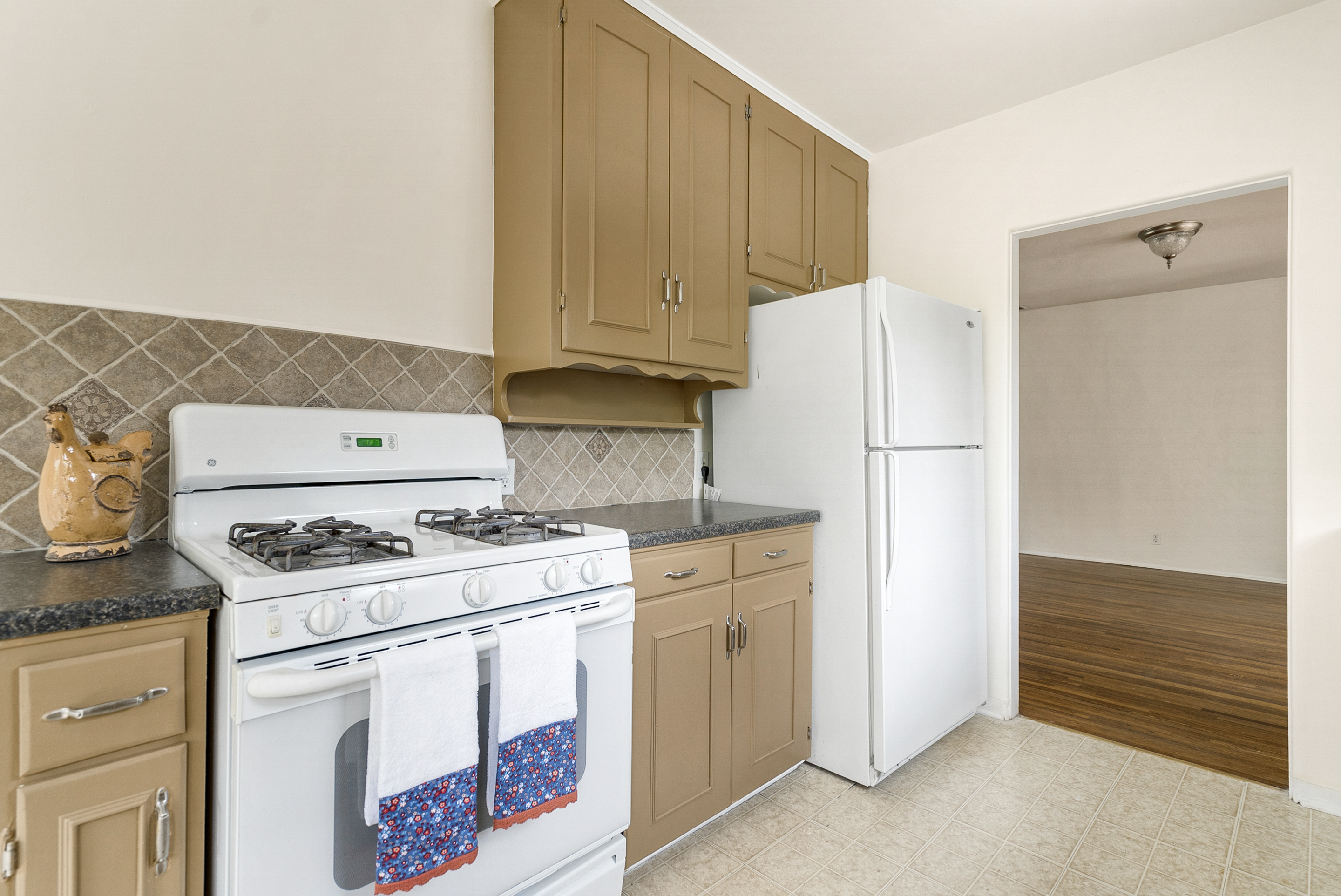 Gas stove and refrigerator included.
