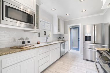 Remodeled kitchen with granite counter tops, tile flooring, stainless steel appliances (negotiable), built-in microwave, dishwasher, and recessed lighting.