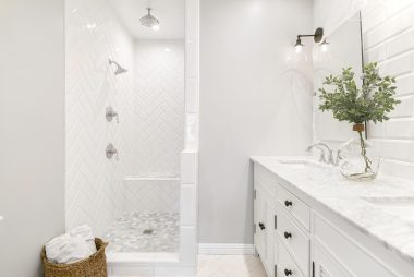 Remodeled master bathroom with marble flooring and counter, and dual sinks too!