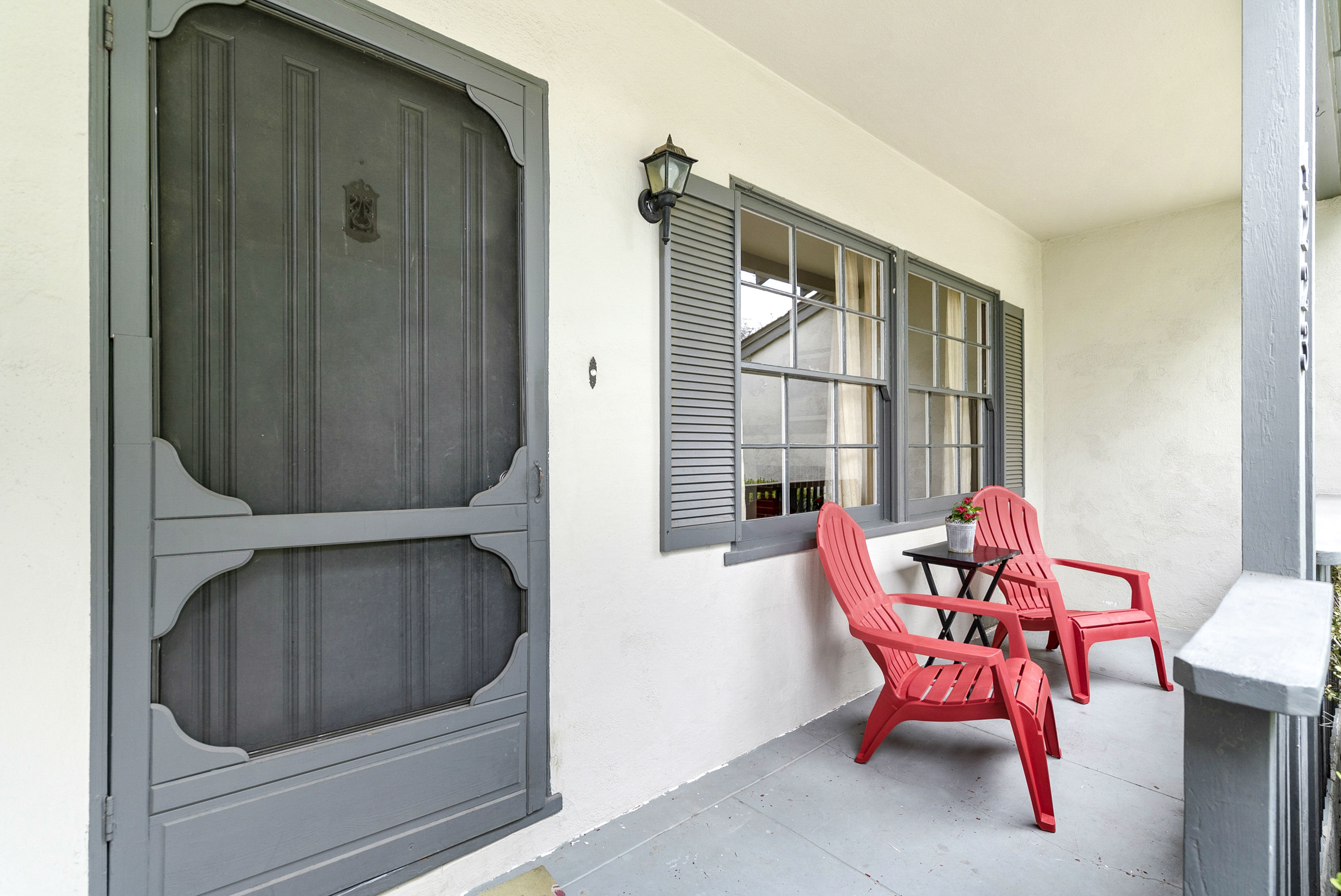 Breezy front porch with Adirondack chairs included.