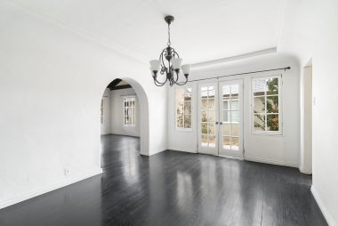 Spacious formal dining room with living room through the arch to the left.