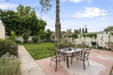 Beautifully landscaped backyard with fruit trees, auto sprinkler system, and a shed behind the garage. Room for gardening and entertaining.
