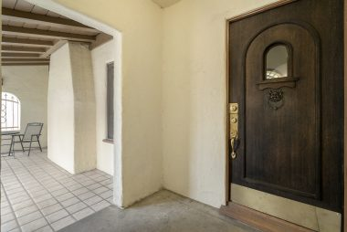 Original front door with large covered and secure porch.