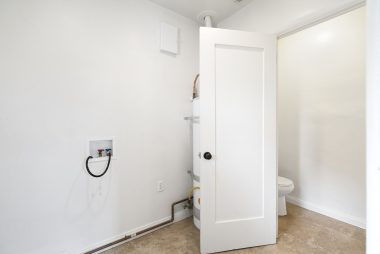 View to left is of laundry room and additional bath. View to the right is into the breakfast nook, then the formal dining room, and far beyond that is the living room.
