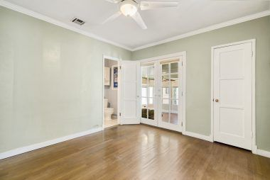 Master bedroom suite with French doors leading to the family room, as well as 3/4 bathroom.