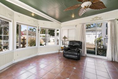 Alternate view of step-down family room overlooking the serene low-maintenance backyard.