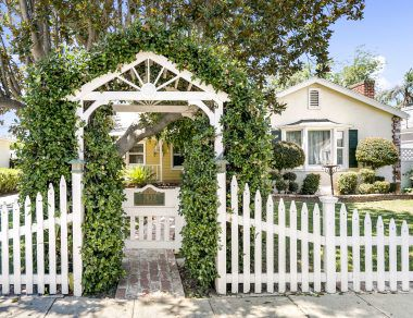 Charming entry gate into the front yard with address placard.