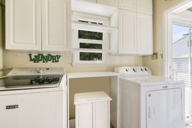 Separate indoor laundry room (appliances included).