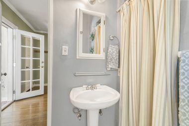 Master bathroom pedestal sink and shower.