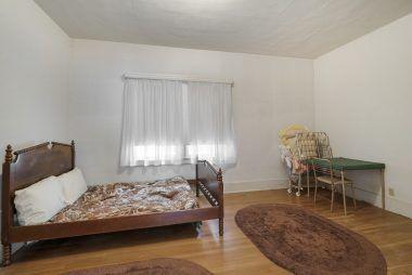 Middle bedroom with hardwood floors.