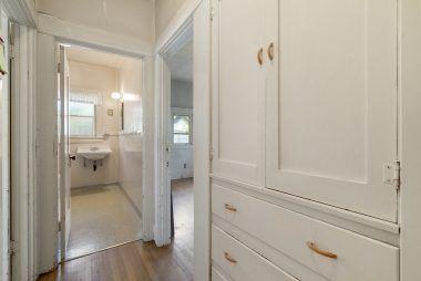 Hallway into bathroom.