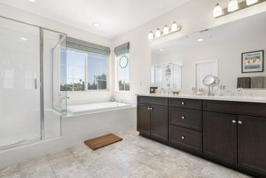 Master bathroom with dual sinks, separate shower and tub, as well as an enormous walk-in closet.