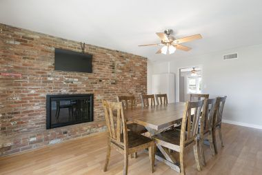 Alternate view of the formal dining room with fireplace.